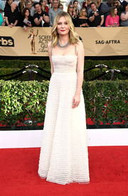 Kirsten Dunst looked angelic in a textured white spaghetti-strap gown by Christian Dior at the SAG Awards.