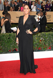 Tracee Ellis Ross stepped onto the SAG Awards red carpet looking diva-ish in a plunging black gown by Ulyana Sergeenko.