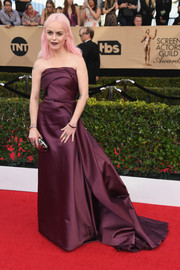 Taryn Manning donned a structured burgundy strapless gown by Rami Al Ali for the SAG Awards.