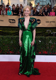 Nicole Kidman stood out in a dramatic green sequin gown with feather sleeves at the SAG Awards.