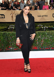 Dascha Polanco flashed her bra in a black tux jumpsuit with a down-to-the-navel neckline at the SAG Awards.