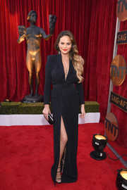 Chrissy Teigen was equal parts smart and sexy in a plunging, high-slit tuxedo dress by Dsquared2 at the SAG Awards.
