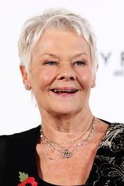 Take your cue from Judi Dench and layer a bunch of thin necklaces to make your accessories stand out even more!
