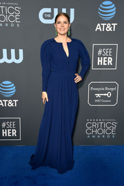 Amy Adams kept it simple and modest in a long-sleeve navy gown by Zac Posen at the 2019 Critics' Choice Awards.