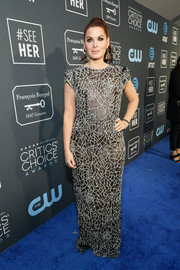 Debra Messing looked daring in a sheer, crystal-embellished column dress by Lucia Rodriguez at the 2019 Critics' Choice Awards.
