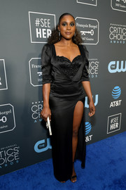 Issa Rae attended the 2019 Critics' Choice Awards wearing a black Aliétte by Jason Rembert column dress with a sweetheart neckline and a thigh-high slit.