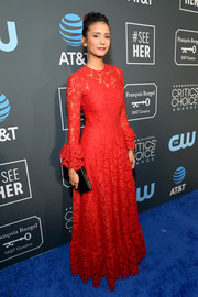 Nina Dobrev looked breathtaking in a red lace gown by Valentino at the 2019 Critics' Choice Awards.
