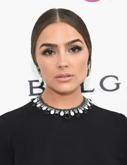 Olivia Culpo wore a conservative center-parted chignon at the Elton John AIDS Foundation Oscar viewing party.