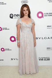 Lana Del Rey kept it demure in a pleated silver gown by Vivienne Westwood Couture at the Elton John AIDS Foundation Oscar viewing party.