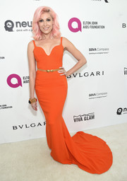Bonnie McKee showed off her shapely figure in this orange fishtail gown during the Elton John AIDS Foundation Oscar viewing party.