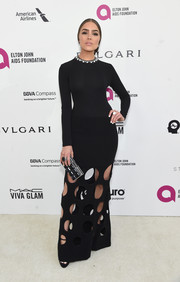 Olivia Culpo teamed her dress with an industrial-chic clutch.
