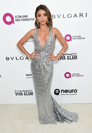 Sarah Hyland brought a high dose of sparkle to the Elton John AIDS Foundation Oscar viewing party with this plunging silver sequin gown by Blumarine.