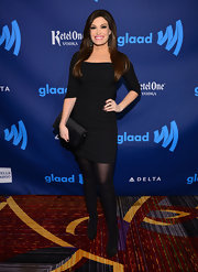 Kimberly Guilfoyle sported a basic little black dress with three-quarter length sleeves for her red carpet appearance.