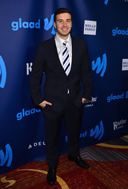 Vinny Guadagnino traded in the Ed Hardy for this classic suit with stylish striped tie.
