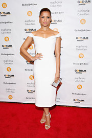 Gugu Mbatha-Raw completed her all-white ensemble with a Lee Savage box clutch.