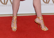 Simple gold satin sandals paired perfectly with Anne Hathaway's evening look.
