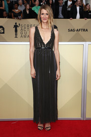 Laura Dern looked effortlessly elegant in a fringed black gown by Dior Couture at the 2018 SAG Awards.