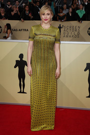 Greta Gerwig was edgy-glam in a studded chartreuse column dress by Bottega Veneta at the 2018 SAG Awards.