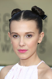 Millie Bobby Brown went for a sweet beauty look with a swipe of pink lipstick.