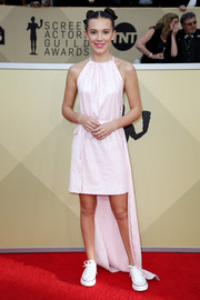Millie Bobby Brown channeled her inner superhero in a caped pink sequin dress from Calvin Klein By Appointment at the 2018 SAG Awards.