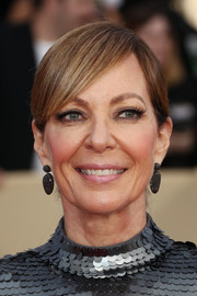 Allison Janney wore her hair in a ponytail with side-swept bangs at the 2018 SAG Awards.