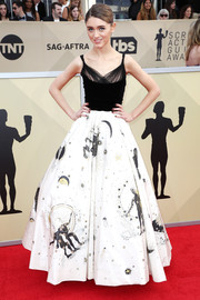 Natalia Dyer looked enchanting at the 2018 SAG Awards in a Dior Couture ball gown with a Swiss dot and velvet bodice and a cosmic-print skirt.