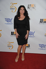 Valerie Bertinelli paired a fitted black dress with sequined nude peep toes.