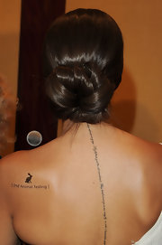 Leona Lewis showed off her script tattoo at the Genesis Awards in LA.