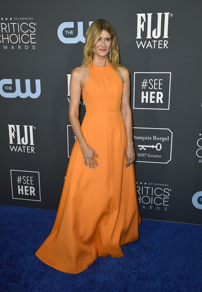 Laura Dern cut a vibrant figure in an orange halter gown by Emilia Wickstead at the 2020 Critics' Choice Awards.