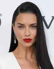 Adriana Lima swiped on some red lipstick for a sexy pout at the Elton John AIDS Foundation Oscar-viewing party.