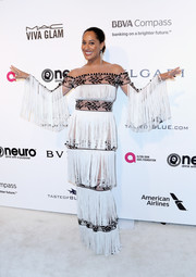 Tracee Ellis Ross looked playfully chic at the Elton John AIDS Foundation Oscar-viewing party in a Yanina Couture gown that featured alternating fringed and embroidered panels.