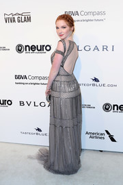 Annalise Basso donned a beaded silver Pamella Roland gown with an open back for the Elton John AIDS Foundation Oscar-viewing party.