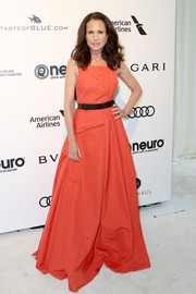 Andie MacDowell went for relaxed glamour in a sleeveless coral gown by Bottega Veneta at the Elton John AIDS Foundation Oscar-viewing party.