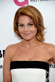 Candace Cameron Bure attended the Elton John AIDS Foundation Oscar-viewing party looking pretty with her voluminous waves.