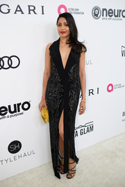 Freida Pinto looked sharp and sexy in a plunging tuxedo gown by Rohit Gandhi + Rahul Khanna at the Elton John AIDS Foundation Oscar-viewing party.