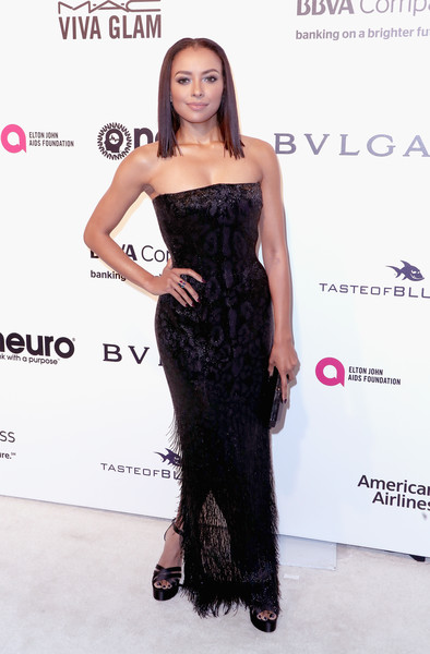 Kat Graham paired her gown with black platform sandals by Neil J. Rodgers.