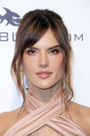 Alessandra Ambrosio looked lovely wearing this loose bun with parted bangs at the Elton John AIDS Foundation Oscar-viewing party.