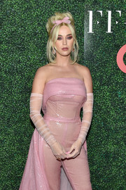 Katy Perry teamed sheer pink full-sleeve gloves with a matching strapless jumpsuit for the FFANY Shoes on Sale Gala.