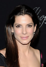 Sandra Bullock paints the perfect pout wit a soft pink hue for the Santa Barbara Film Festival.
