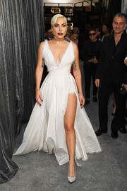 Lady Gaga polished off her look with a pair of white satin pumps by Jimmy Choo.