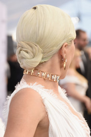Lady Gaga styled her platinum-blonde locks into a twisted bun for the 2019 SAG Awards.