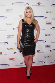 Lindsey Vonn pared down her glitzy sequined frock with black suede pumps.