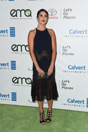 Nikki Reed finished off her outfit with a pair of black gladiator heels by Jimmy Choo.