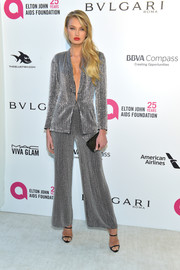Romee Strijd went for relaxed glamour in an embellished silver pantsuit at the Elton John AIDS Foundation Oscar-viewing party.