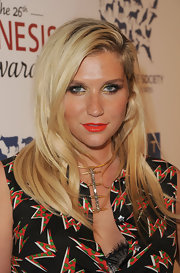 Kesha wore a glossy hot orange lipstick while attending the 26th Annual Genesis Awards.