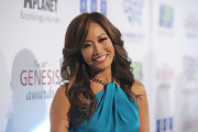 Carrie Ann Inaba arrived at the 26th Annual Genesis Awards wearing her long layered hair in feathered waves and curls.