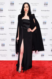Krysten Ritter layered a black cape over her dress for extra drama.