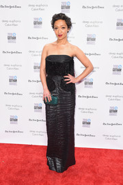 Ruth Negga added a pop of color with a beaded emerald-green clutch by Judith Leiber.