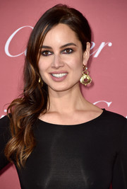 Berenice Marlohe rocked gothic eye makeup in black, brown, and a hint of purple.