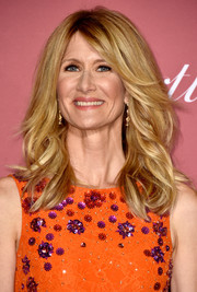 Laura Dern wore her hair in stylish high-volume layers during the Palm Springs International Film Festival Awards.